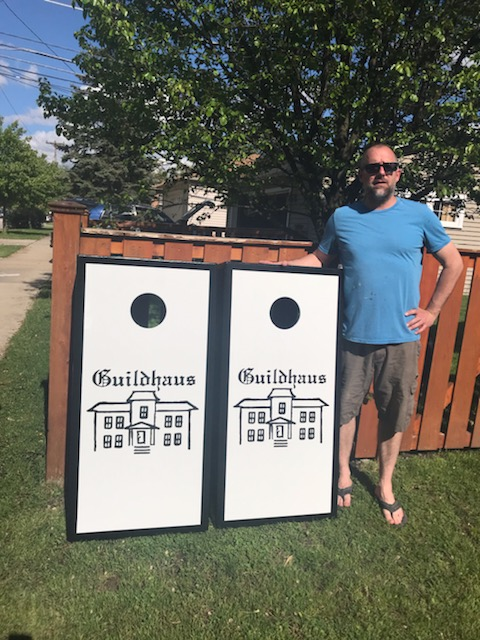 Tom of Chi-Town Custom Cornhole Boards with the beautifully crafted set for our friends at Guildhaus