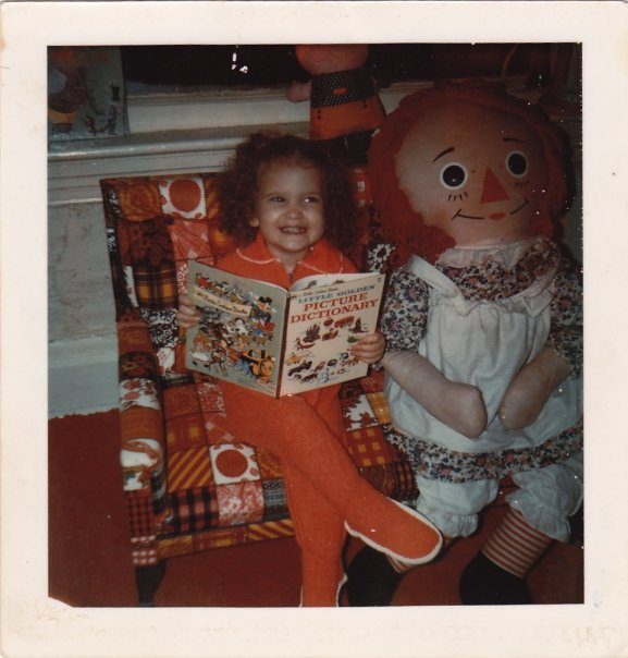 Here I am, age 3. Yes, I staged this photo myself. I really liked red.