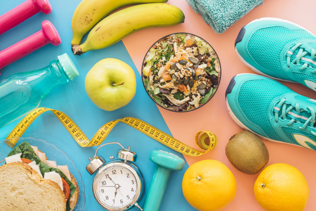 workout-composition-with-healthy-food_23-2147692092.jpg