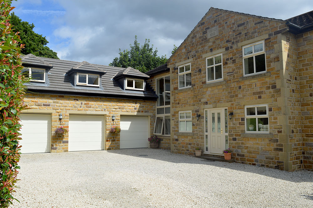 triple garage extension and glass link