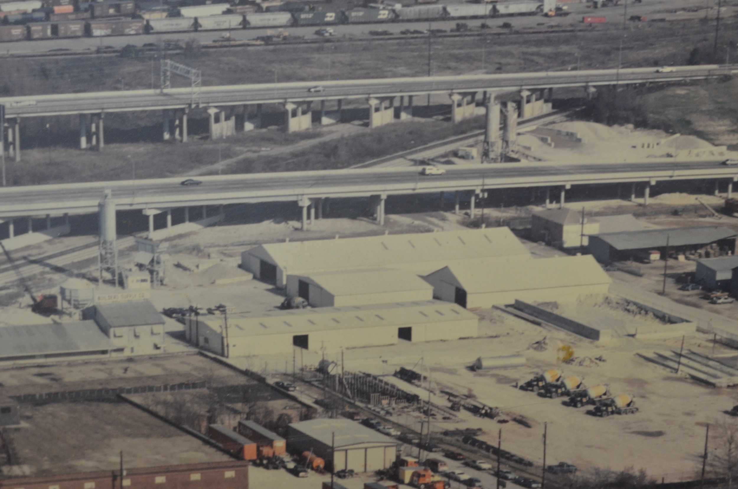 This aerial photo from 1988 shows the office and warehouse on Marshall St and the new building material warehouses. The cement silo that was originally located near the end of the main warehouse was moved near the aggregate bin to create a concrete plant on 3rd street. A second concrete plant was added on 4th street in 1971. You can also see original crane and gravel bin from 1932.