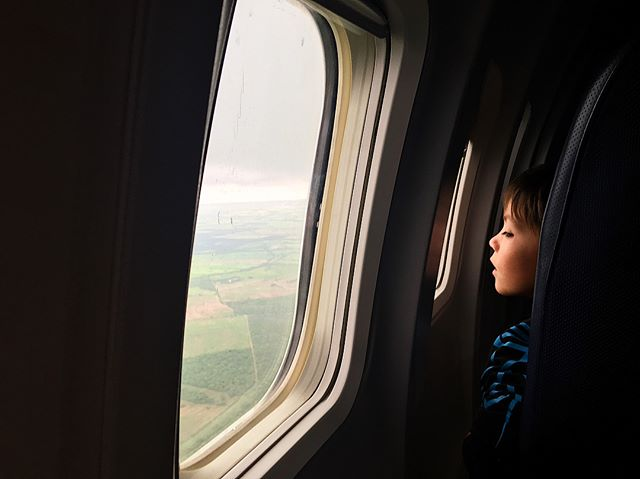 "I shot this photo of a boy on a flight to Mexico last year.  The plane was about thirty minutes out from the airport - we had just descended down from the clouds and the ocean finally came into view.  The city glimmered in the distance but below us, green fields and rivers littered the expanse.  Men herded cattle the size of ants and for a second it all felt so meaningless.  Yet in that was the beauty. ———- I was looking out the window when a slight movement caught the corner of my eye and I turned.  Through the small space between the seats in front of me, I saw a mesmerized little boy peering out through his airplane window. ———- "" What a cute little kid"", I thought to myself, ""I wonder what he must be thinking."" ———- Then I realized that I had been doing just the exact same thing a second before. ———- We live, we grow, and we mature - but we never stop being little humans.  #perspective #PLANESTORIES  PART ONE"