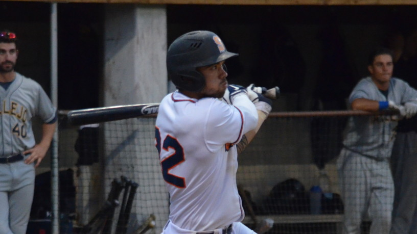 Mark Hurley drives home Brennan Metzger with an RBI single in the seventh. Hurley had three hits on the night.   James Toy III/Sonoma Stompers
