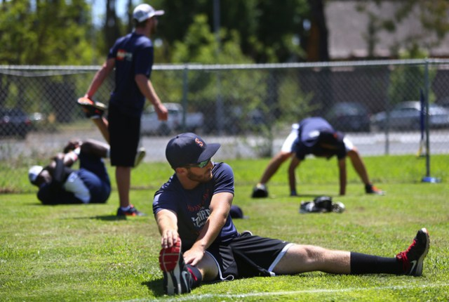 Sonoma Stompers pitcher Sean Conroy stretches during practice Tuesday at Arnold Field in Sonoma. Conroy, 23, of Clifton Park, N.Y., is the first openly gay player to enter the professional baseball ranks, according to the Stompers.   Christopher Chung//AP via The Press Democrat