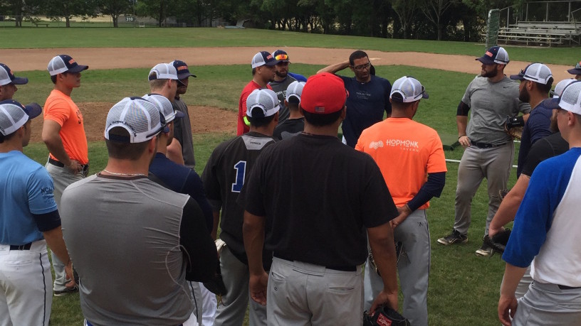 Players gather around manager Fehlandt Lentini on the first day of Spring Training.   Tim Livingston/Sonoma Stompers