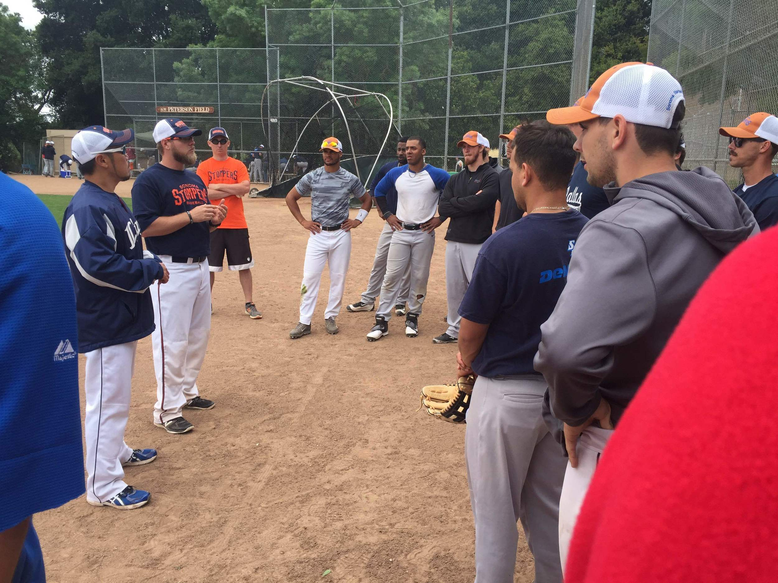 Manager Takashi Miyoshi and bench coach Chris Mathews address the team.   Tim Livingston/Sonoma Stompers