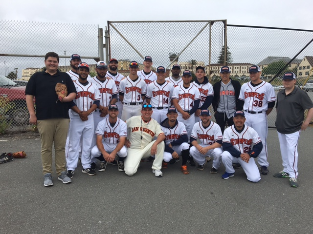 Members of the Sonoma Stompers Professional Baseball Club staff and team gather outside of San Quentin State Prison Saturday.