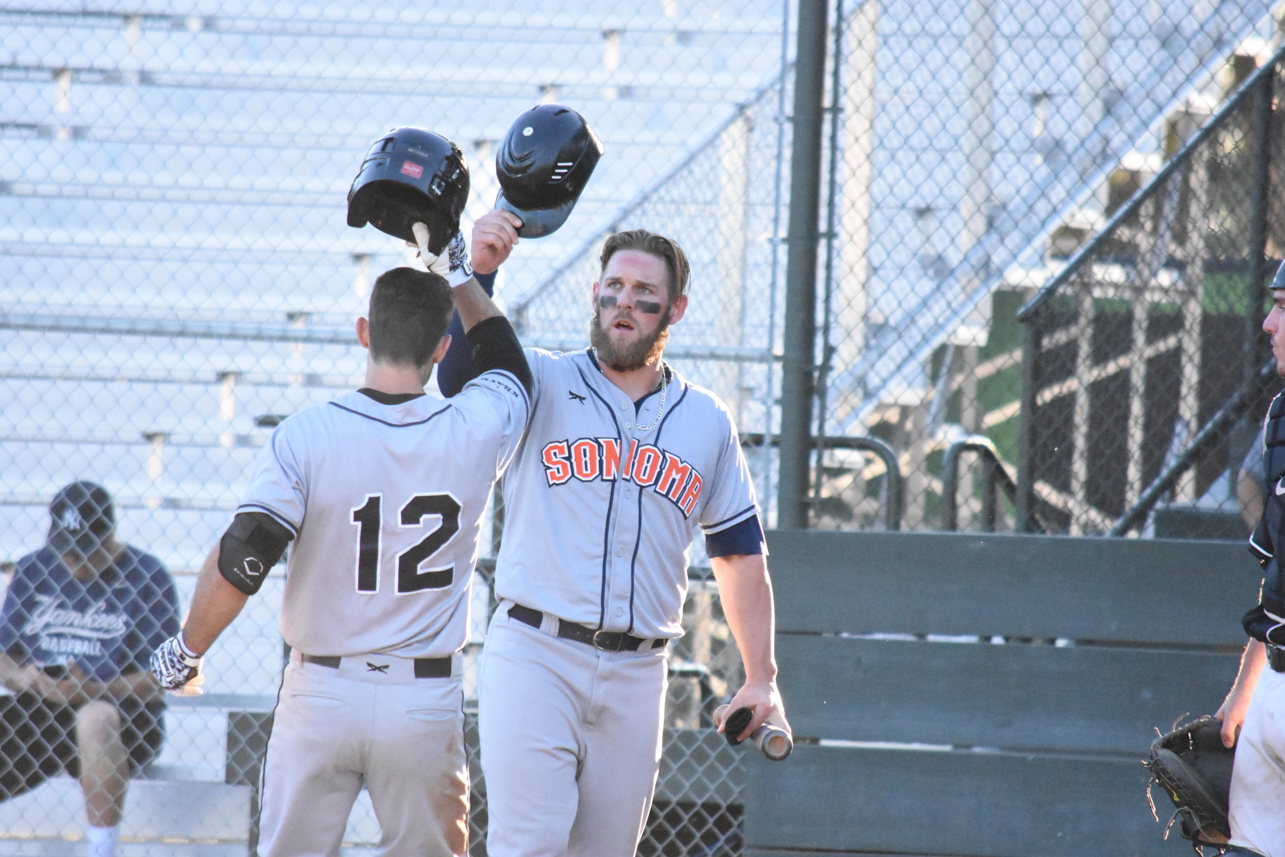 Brennan Metzger (left) hit a home run in the eighth inning of Saturday night's 7-5 win over the Pittsburg Diamonds, securing the Sonoma Stompers' first series victory of the season. (James W. Toy III / Sonoma Stompers)