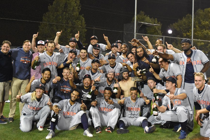 The Sonoma Stompers celebrate after clinching the Pacific Association first half title for the third year in a row with a 6-5 victory over the Pittsburg Diamonds. (James W. Toy III / Sonoma Stompers)