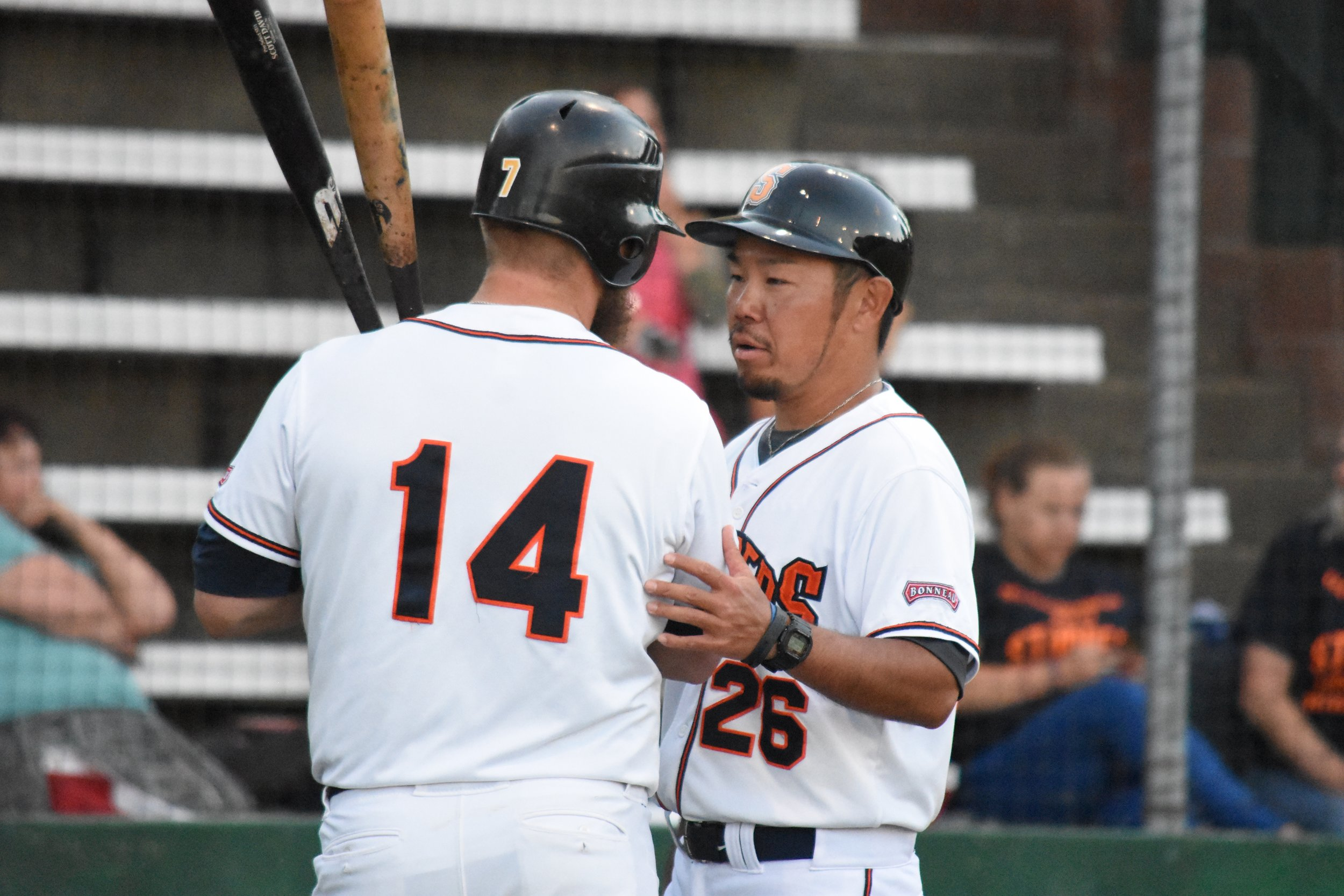 Manager Takashi Miyoshi talks with Scott David at Peoples Home Equity Ballpark at Arnold Field during the 2017 season. (James W. Toy III / Sonoma Stompers)
