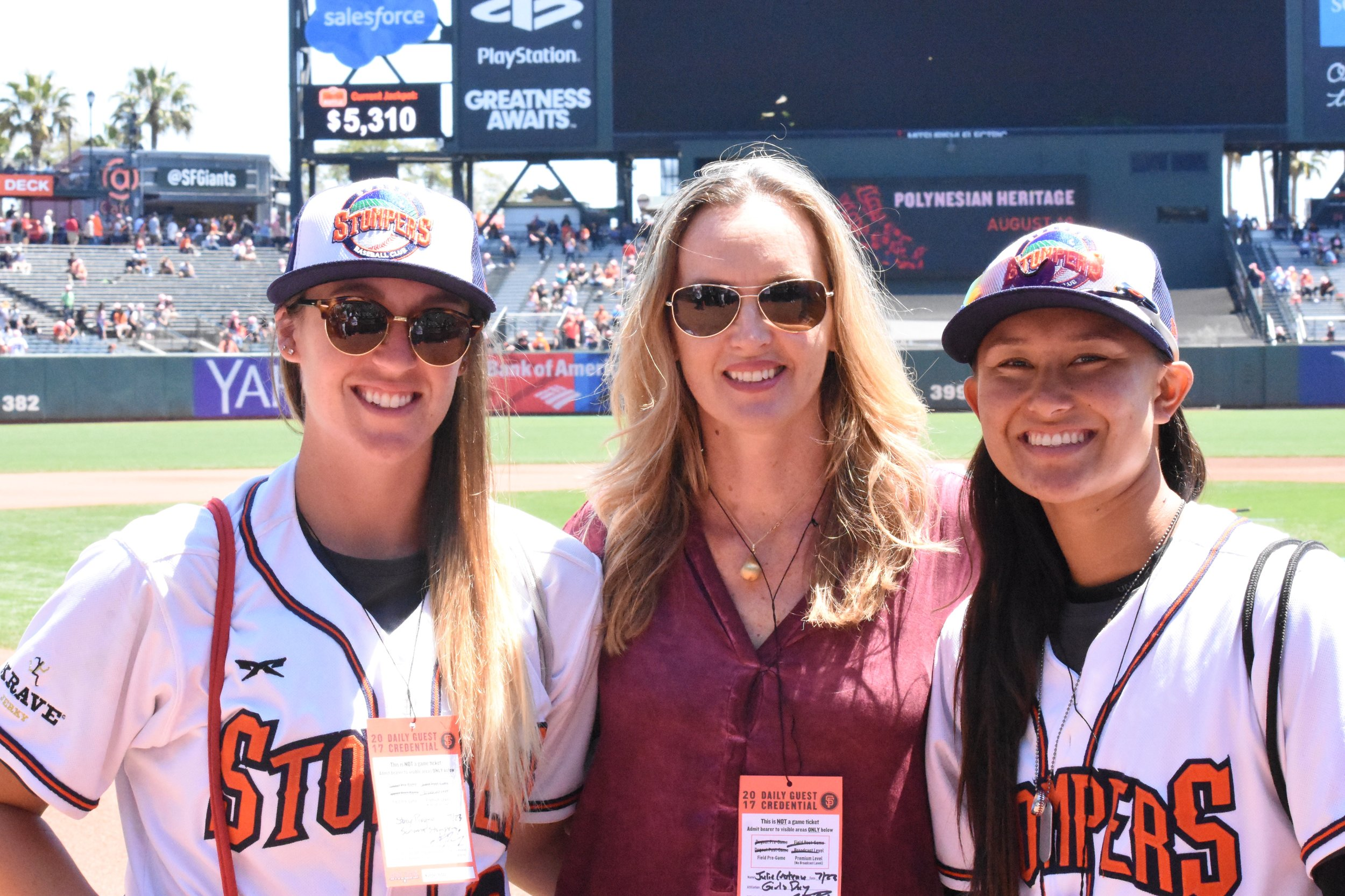 Stacy Piagno (left) and Kelsie Whitmore (right) pose with Julie Croteau, the first woman to play men's NCAA baseball, on the field at AT&T Park on Sunday. (James W. Toy III / Sonoma Stompers)