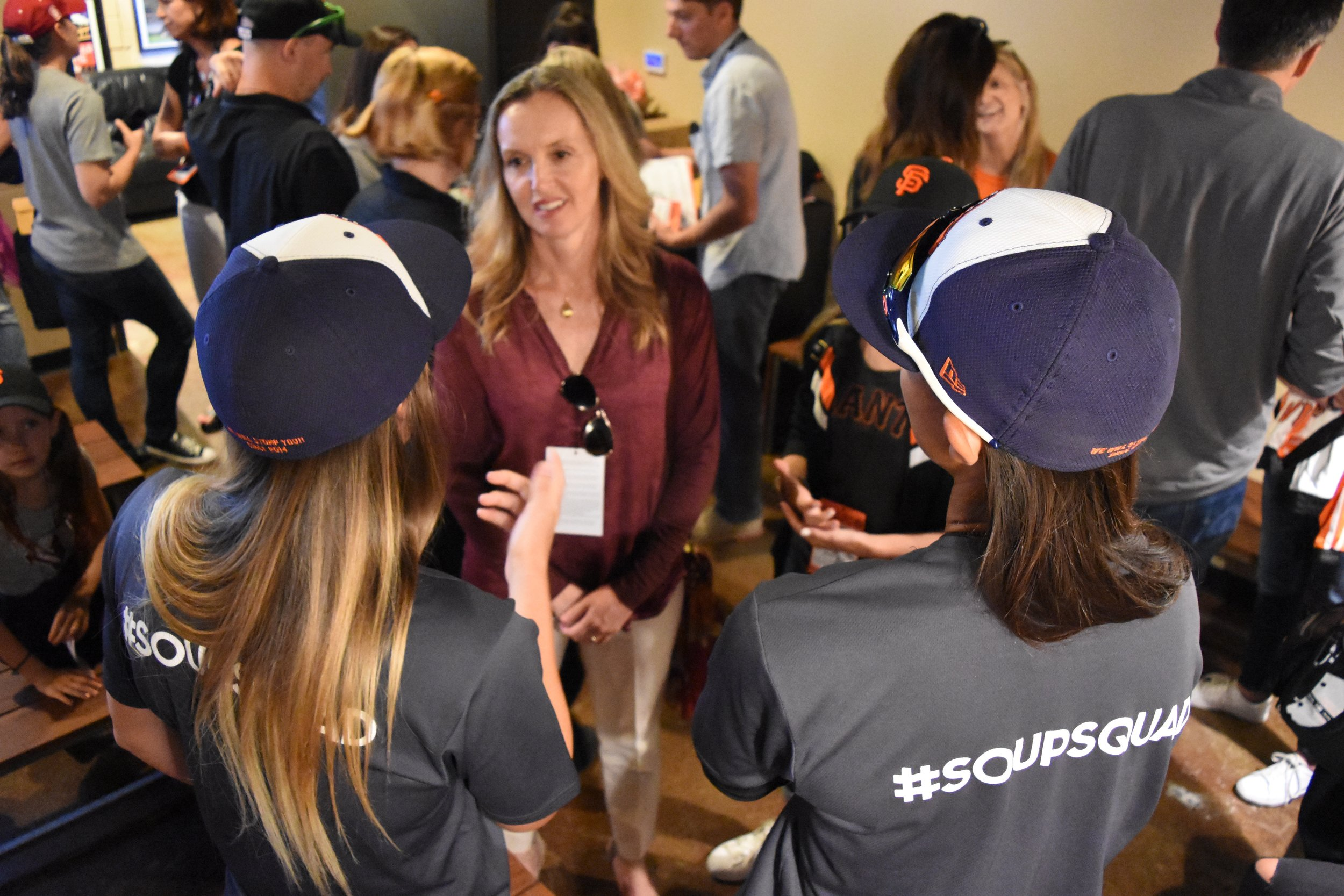Stacy Piagno (left) and Kelsie Whitmore (right) chat with Julie Croteau, the first woman to play men's NCAA baseball, at AT&T Park on Sunday. (James W. Toy III / Sonoma Stompers)