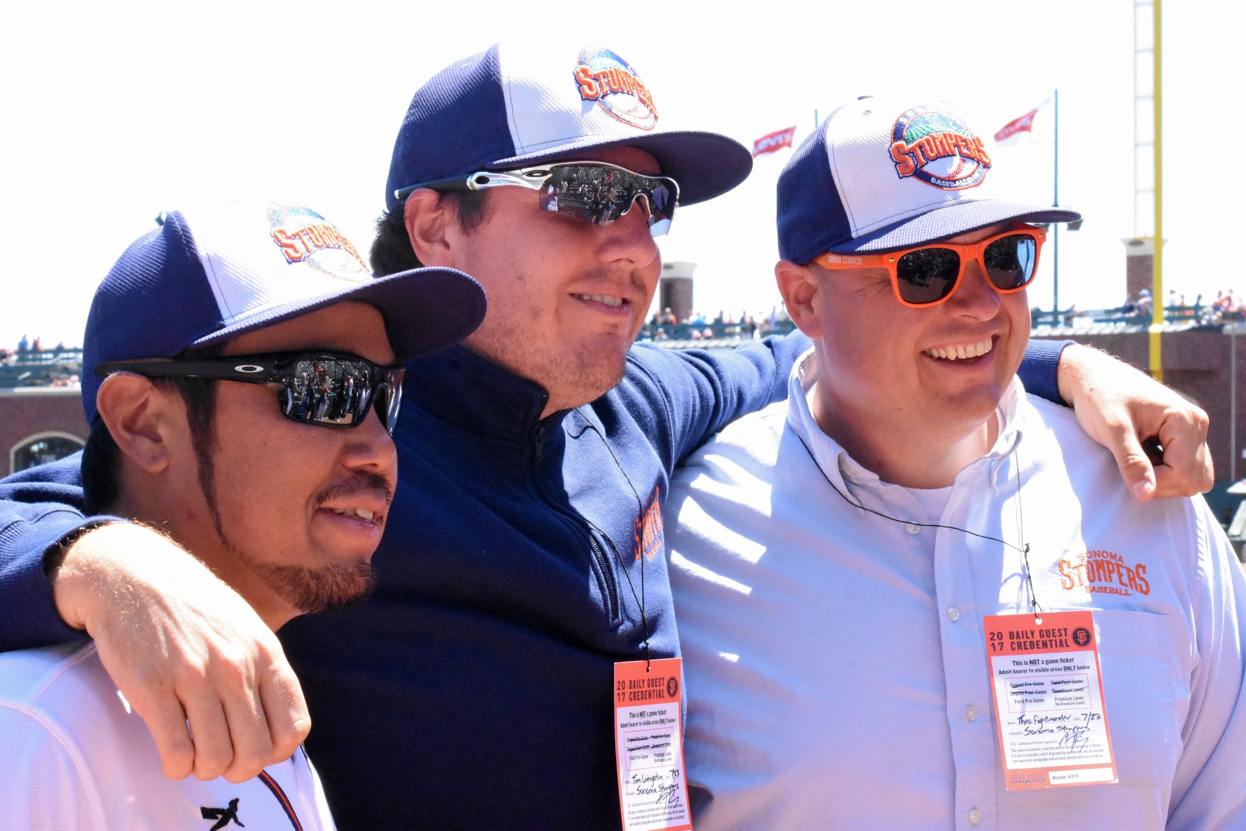 """Takashi Miyoshi, Tim Livingston and Theo Fightmaster take part in a pre-game ceremony on """"Girls Day"""" at AT&T Park on Sunday. (James W. Toy III / Sonoma Stompers)"""