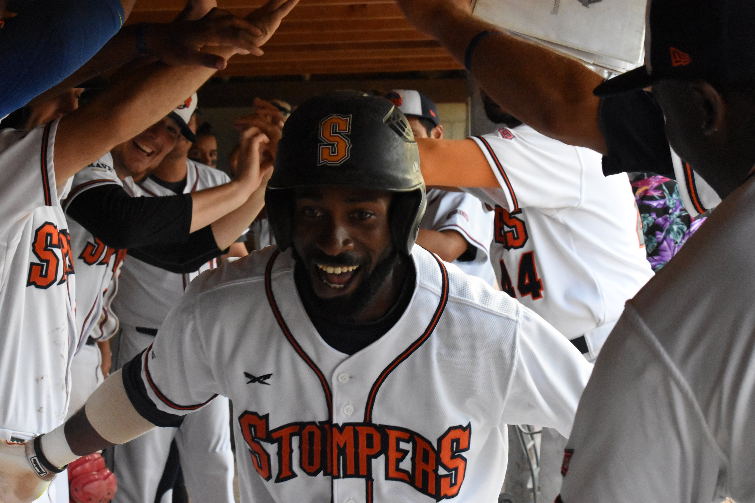 Derrick Fox is greeted with a tunnel in the dugout after hitting a solo home run in the third inning of Wednesday's 7-3 loss to the Vallejo Admirals at Peoples Home Equity Ballpark at Arnold Field. (James W. Toy III / Sonoma Stompers)