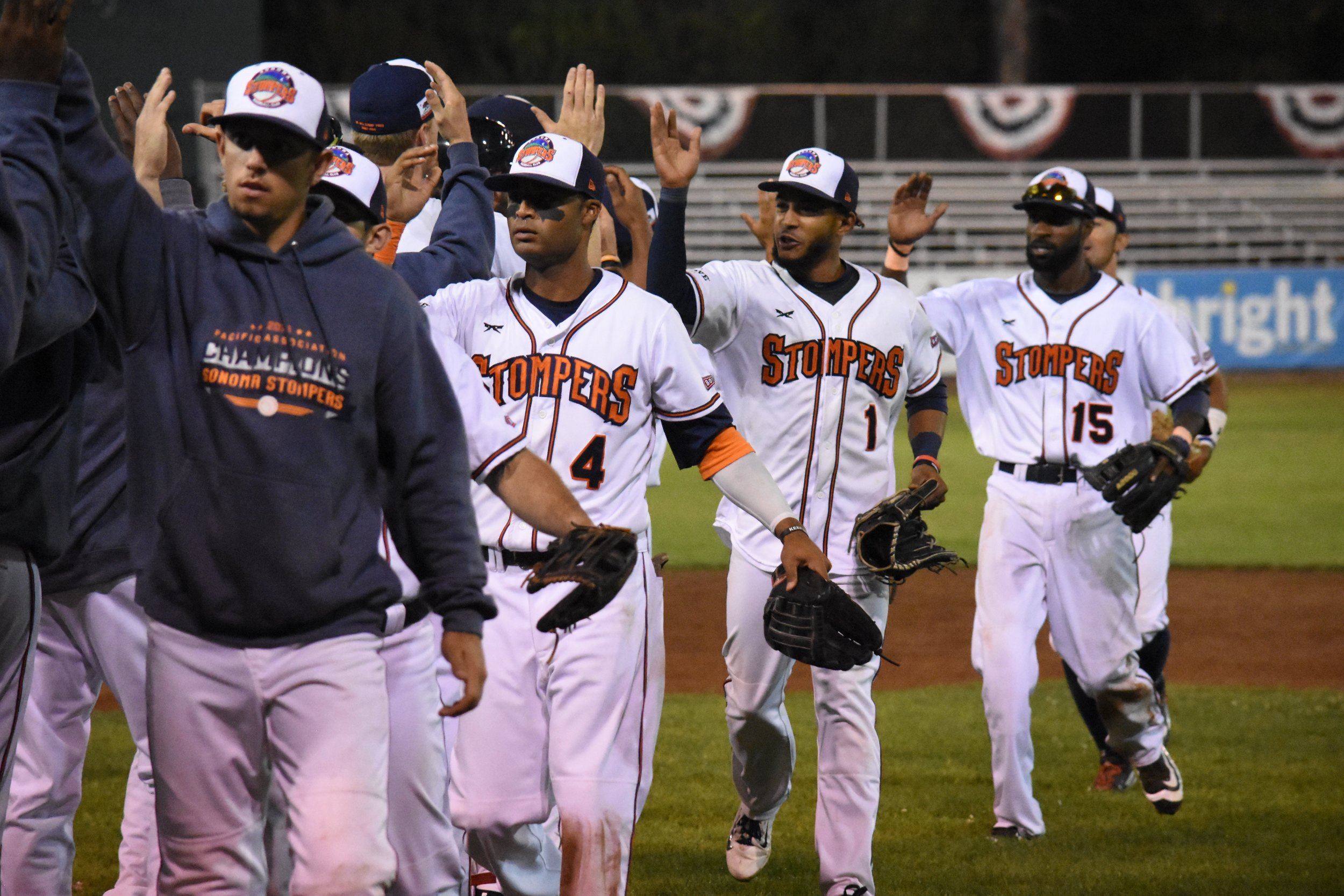 The Sonoma Stompers celebrate on the field at Peoples Home Equity Ballpark after securing a 6-5 win over the Vallejo Admirals in their last regular season home game on Sunday. (James W. Toy III / Sonoma Stompers)