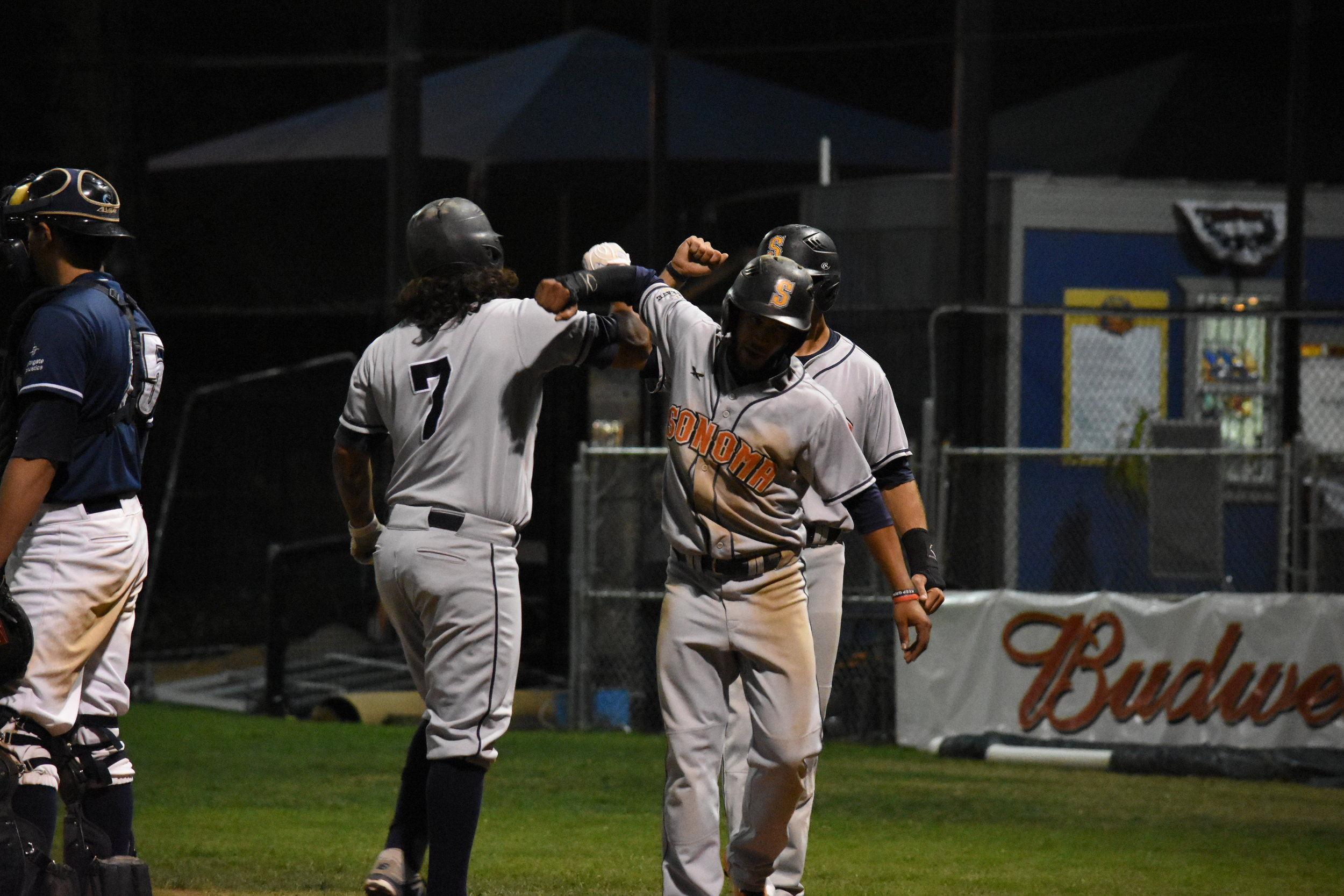Joel Carranza (left) hit a grand slam in Wednesday's 10-5 victory over the San Rafael Pacifics at Albert Park. (James W. Toy III / Sonoma Stompers)