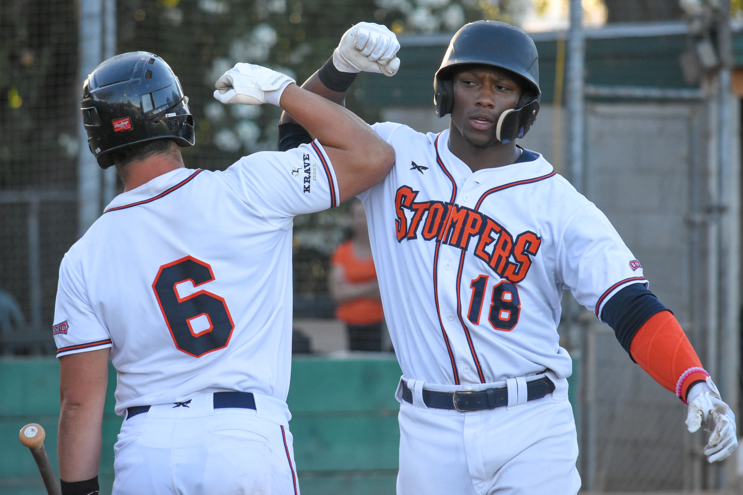 Miles Williams (18) celebrates with Daniel Comstock (6) after hitting his second home run of the game in the fifth inning on Saturday, July 7th, 2018. (James W. Toy III / Sonoma Stompers)
