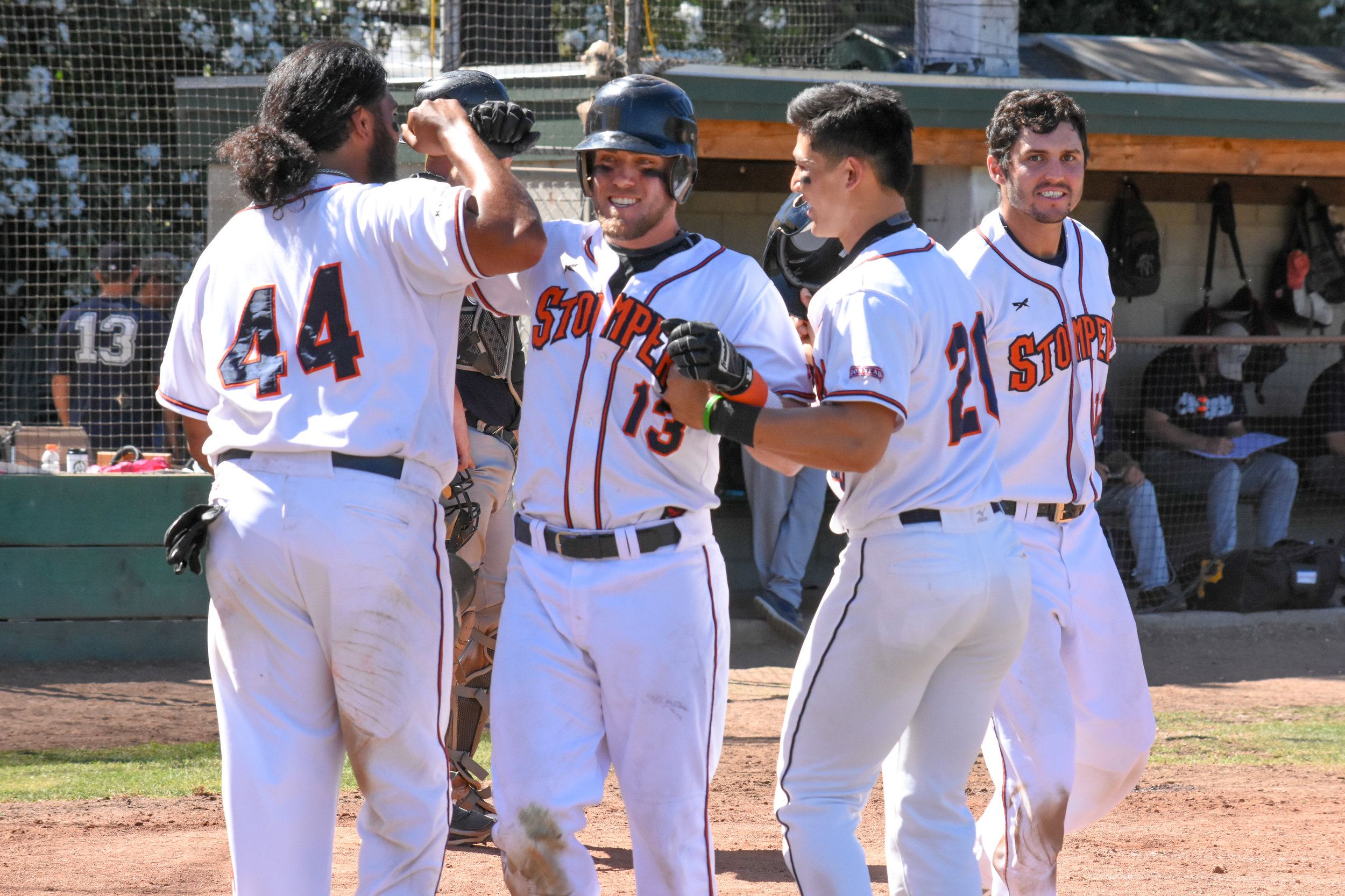 Kevin Farley (13) celebrates with Daniel Baptista (44) and Mitchell Ho (20) after hitting a go-ahead grand slam in the 7th inning on Sunday, July 8, 2018 (James W. Toy III / Sonoma Stompers)