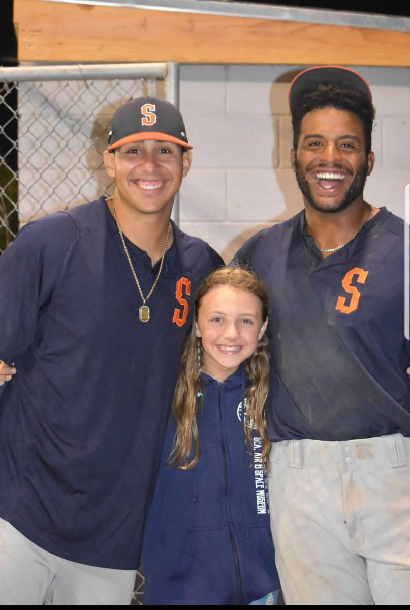 Sluggers Jacob Barfield and Dondrei Hubbard taking a photo with a fan