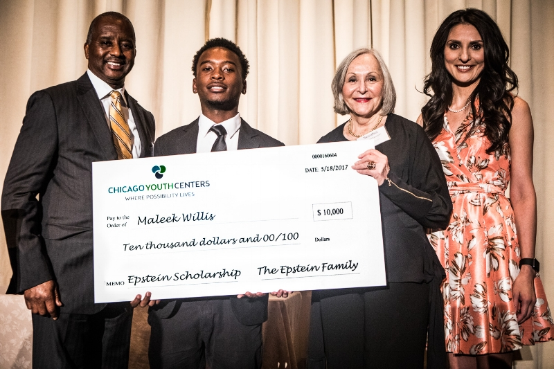 Left to right: CYC Board Member Al Reid, Epstein Scholar   Maleek  Willis, Sondra Berman Epstein, and Master of Ceremonies Rosa Flores during the Epstein Scholarship Award presentation. This year's $10,000 award was made possible by the Epstein Family and Rivers Casino. Al Reid and his family gave Maleek a new laptop.