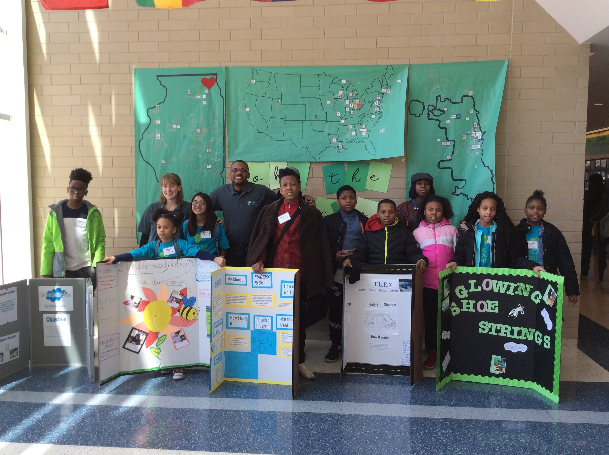 CYC students and staff stand with the inventions and presentations they brought to the chicago student invention convention.