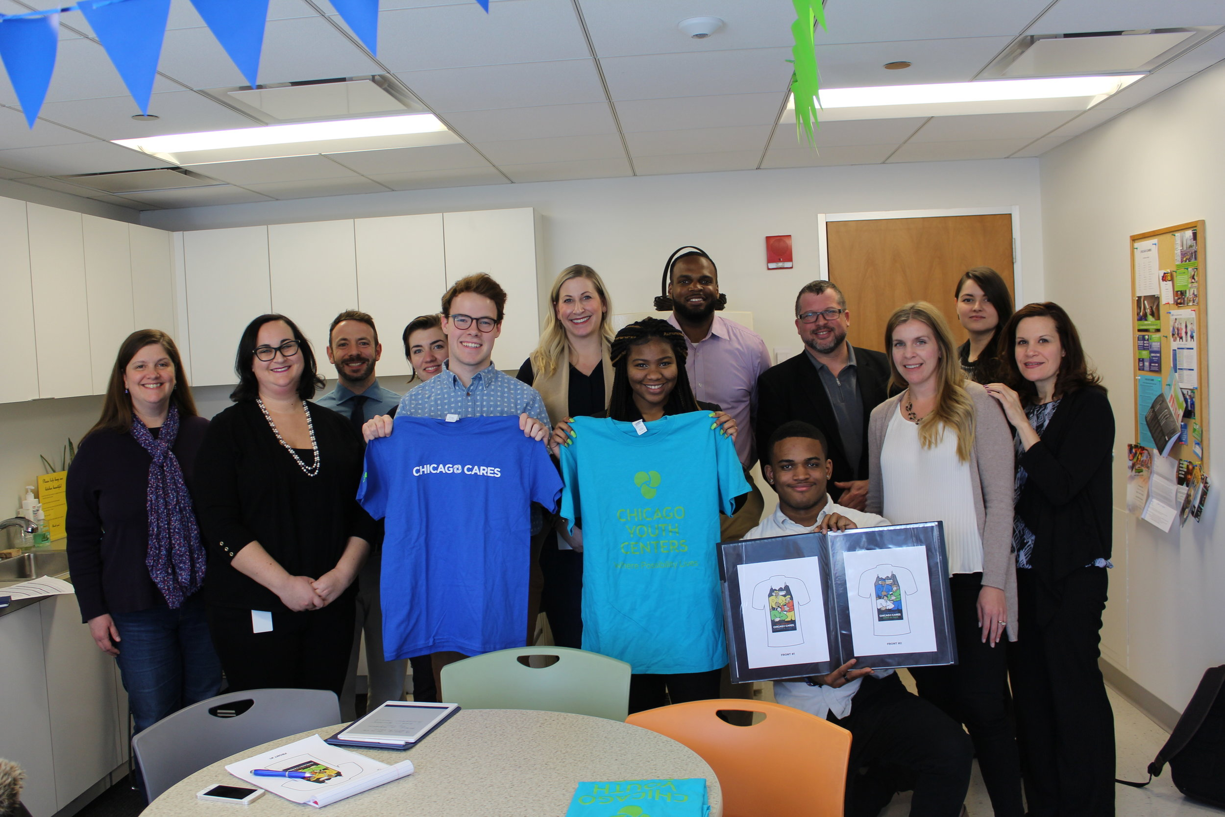 The Chicago Cares executives and CYC staff and teens posed for a photo after the business meeting.