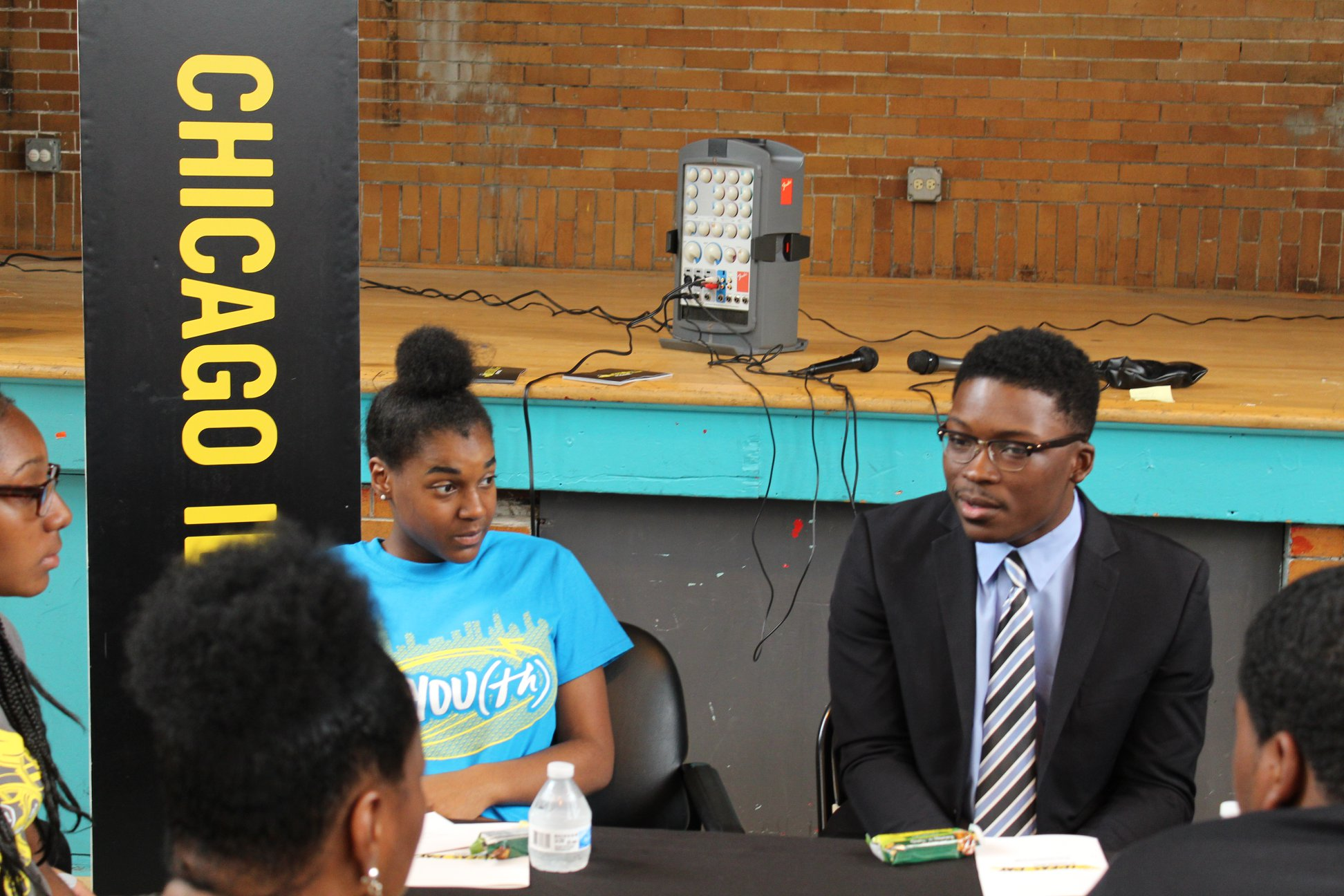 Community activist and mayoral candidate Ja'Mal Green discusses youth impact with CYC teens.