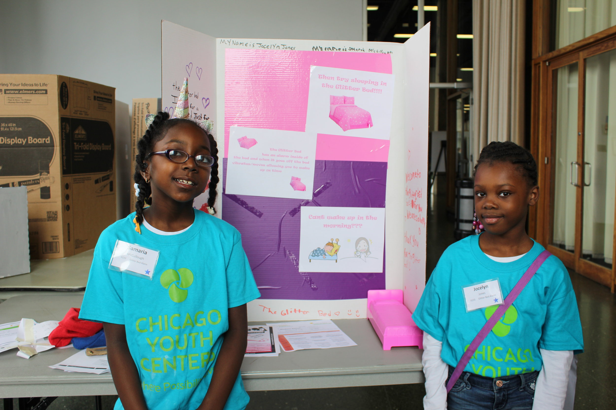 Samaria and jocelyn present their invention at the event.