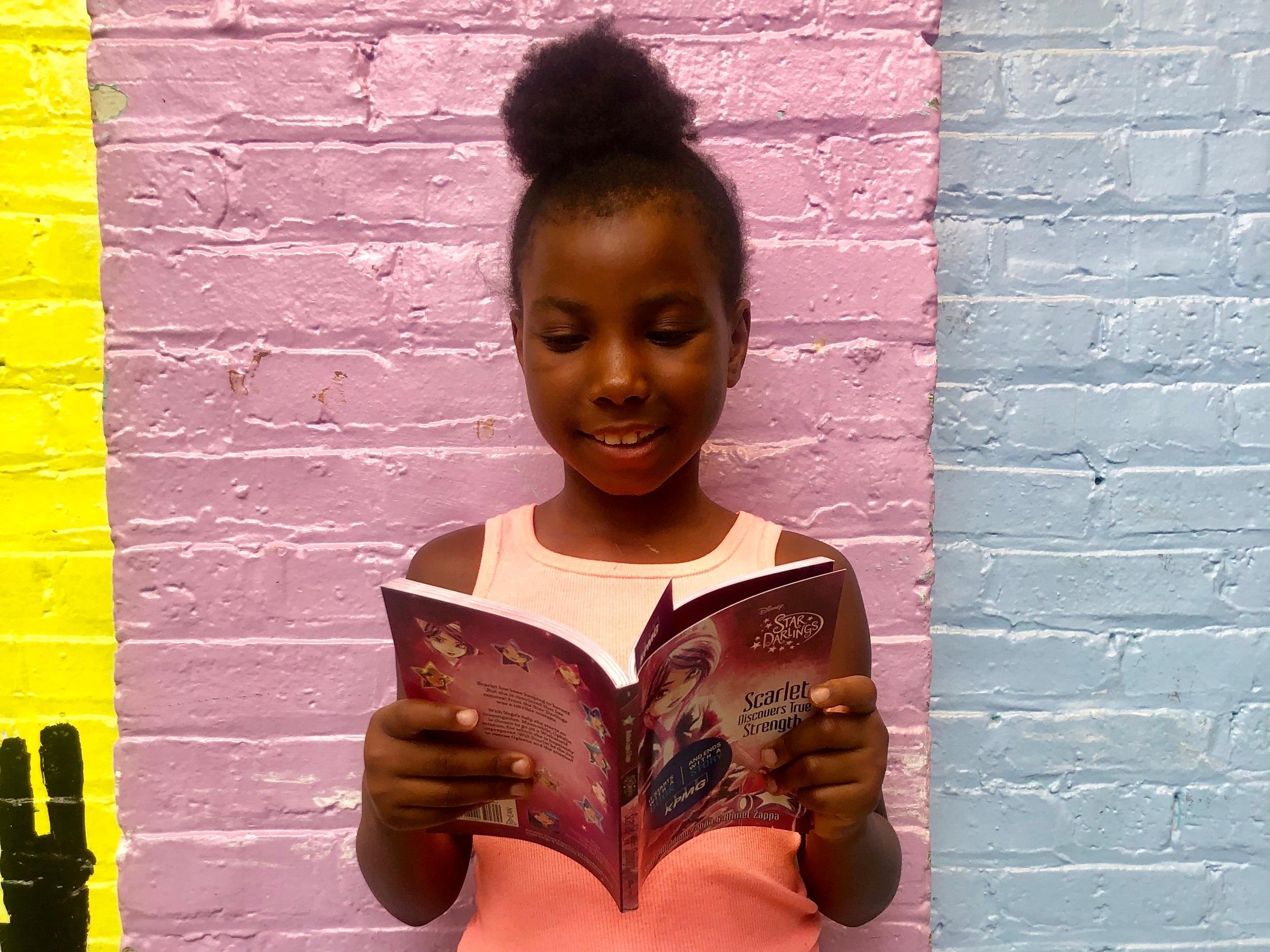 Aniya reads her favorite book this summer.