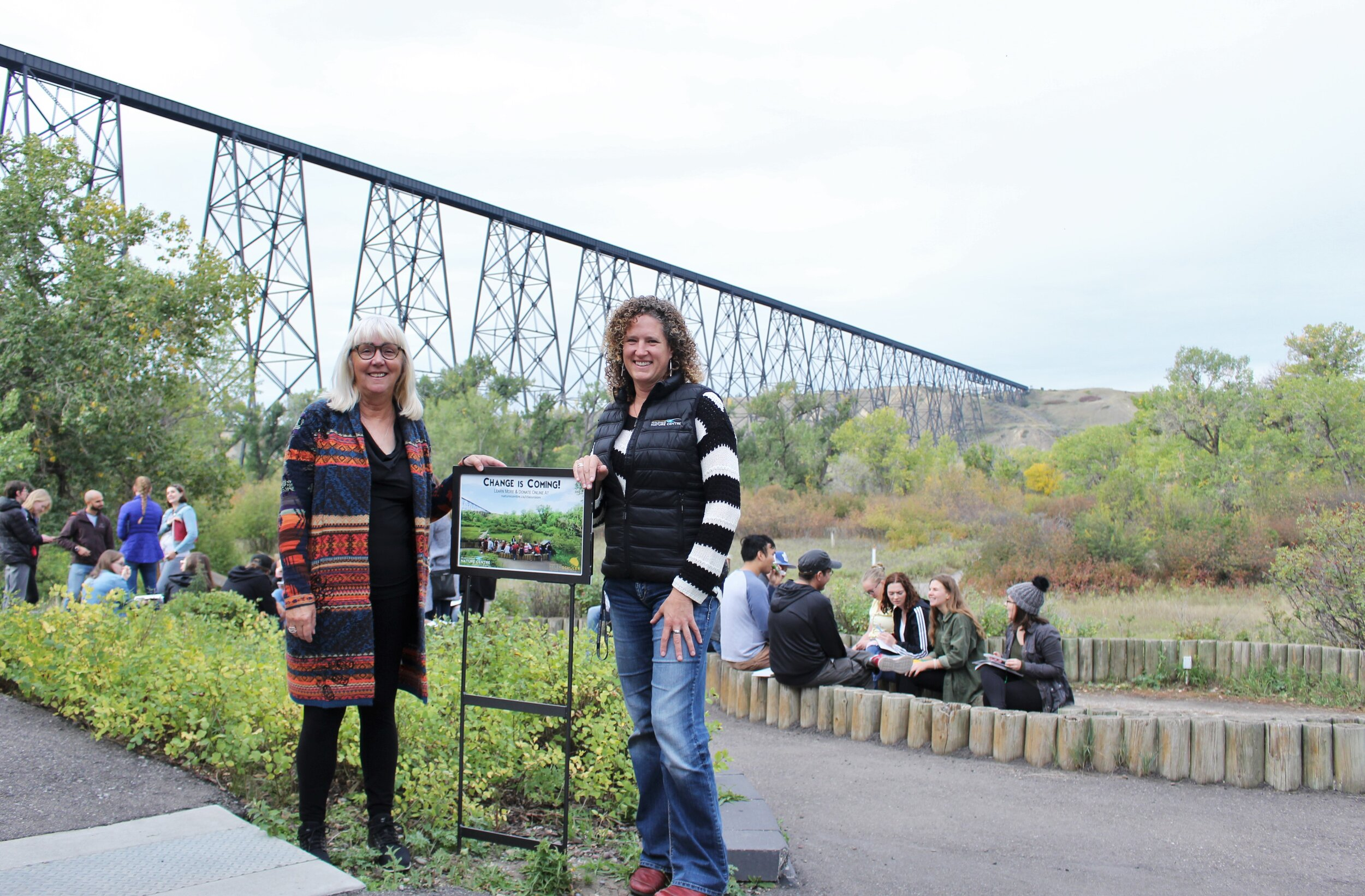 Carol Leriger and Coreen Putman pose for a 'Before' photo at the existing amphitheatre site at the Helen Schuler Nature Centre. September 2019.