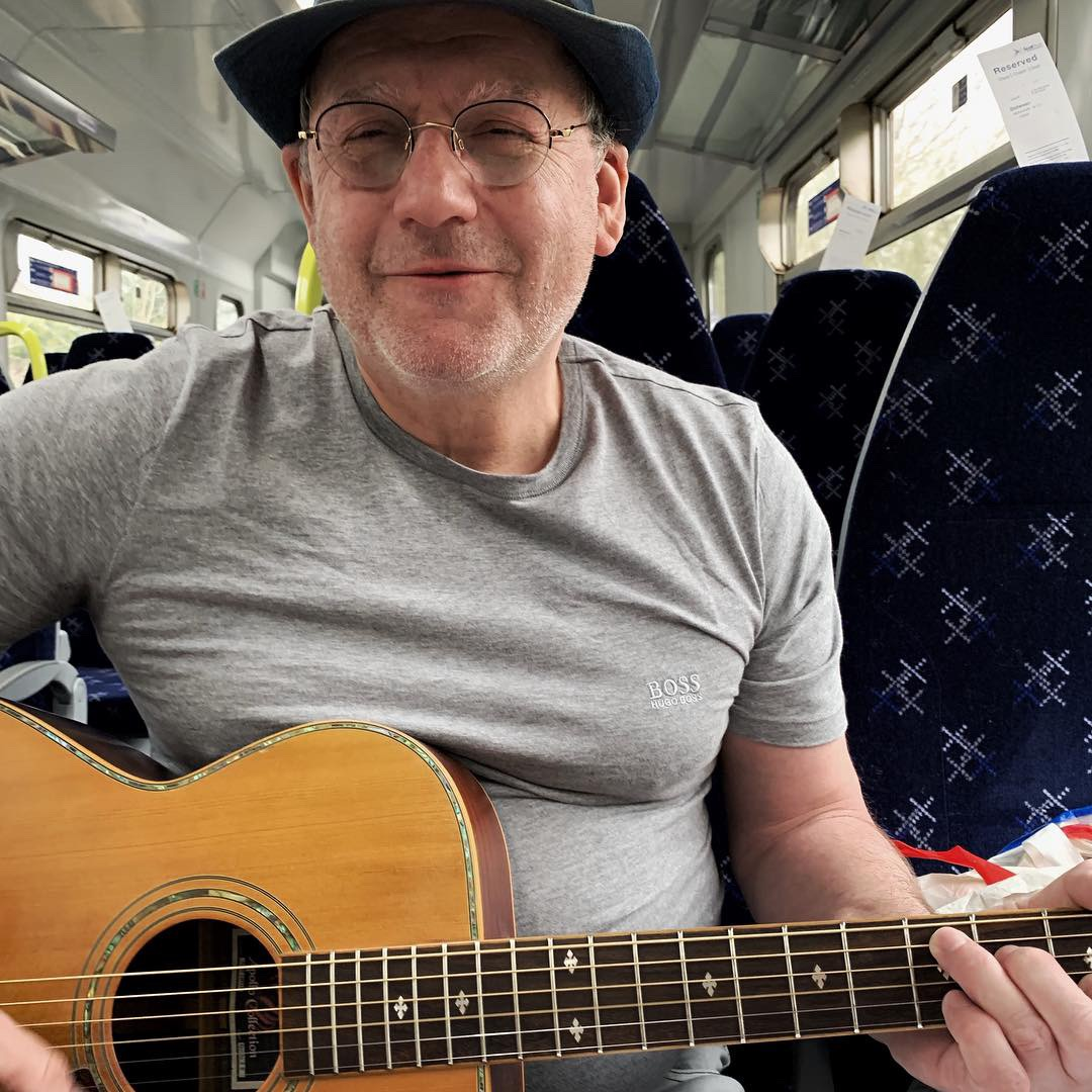 John, the musician on the Scots Rail train from Glasgow to Oban. photo by anne richardson