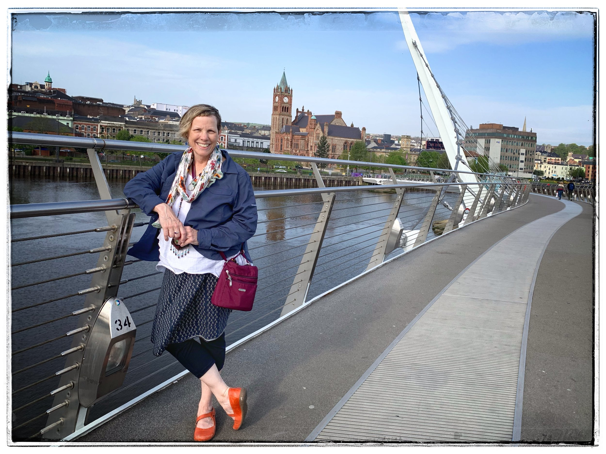 Crossing the Peace Bridge on a beautiful first day in Derry. Many famous people have walked across this bridge as well as everyday folk. It is a powerful symbol of healing. photo by Lauren Richardson.