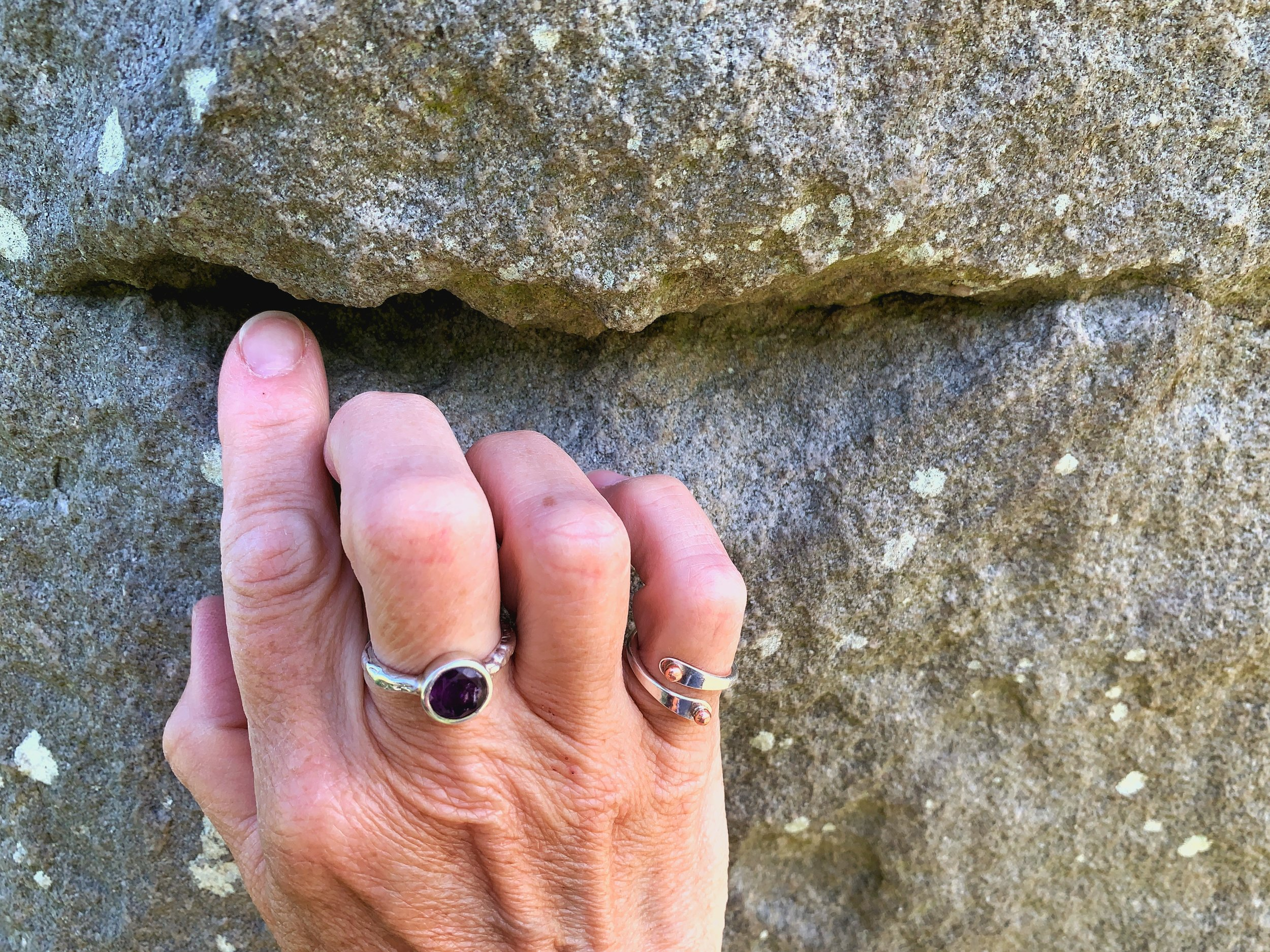 Connecting with Sacred Stones at Avebury Stone Circle. Photo by anne richardson.