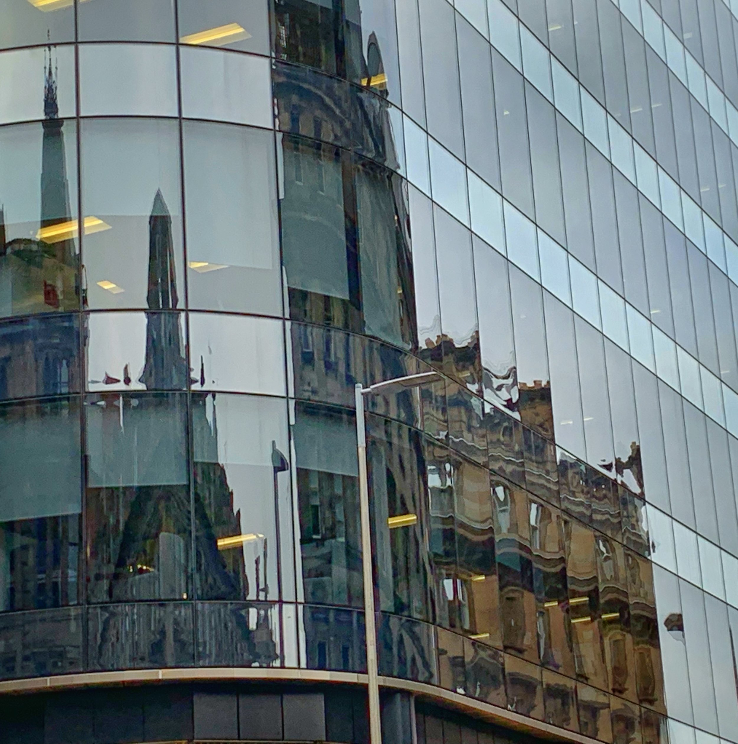Old architecture reflected in new. A fitting metaphor for my sojourn. Glasgow, Scotland. photo by anne richardson