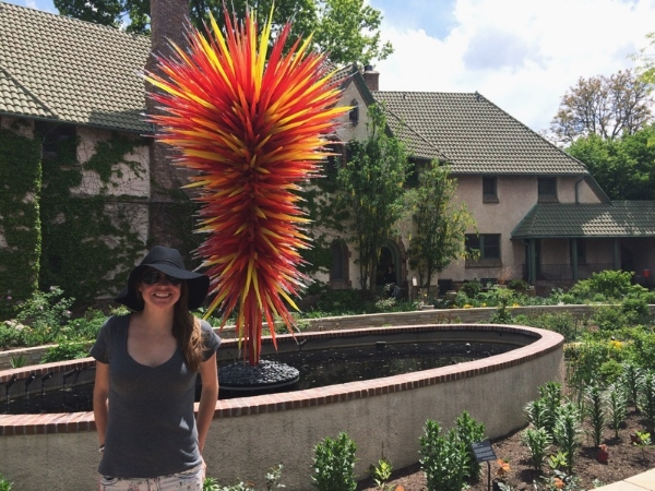 "Rima and an art piece by Chihuly - I call   it ""Chihuly and cheese"""