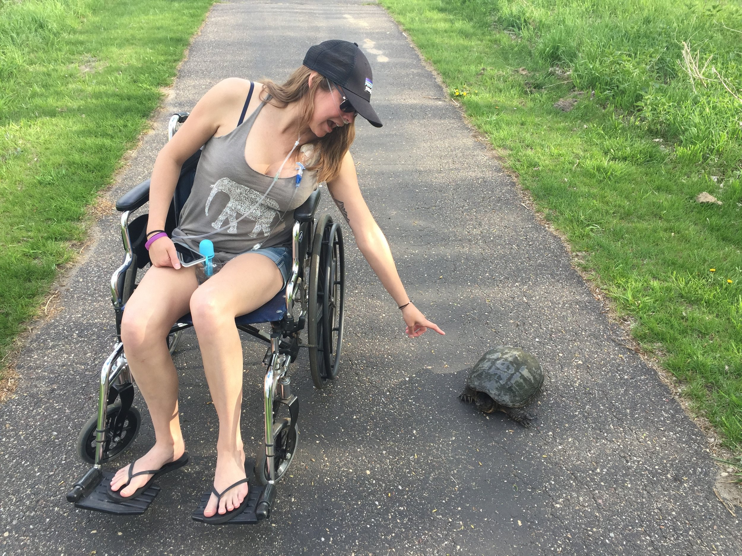 We ran into a turtle on our roll n' stroll, she tried to boop his nose.