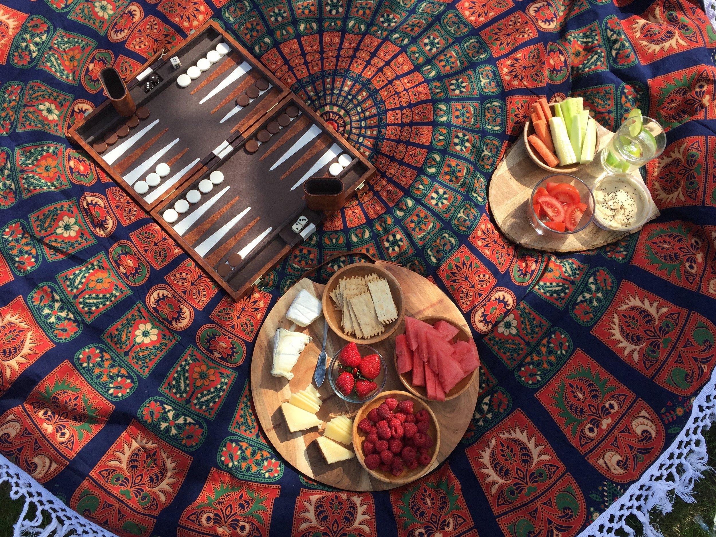 backyard picnic spread and backgammon