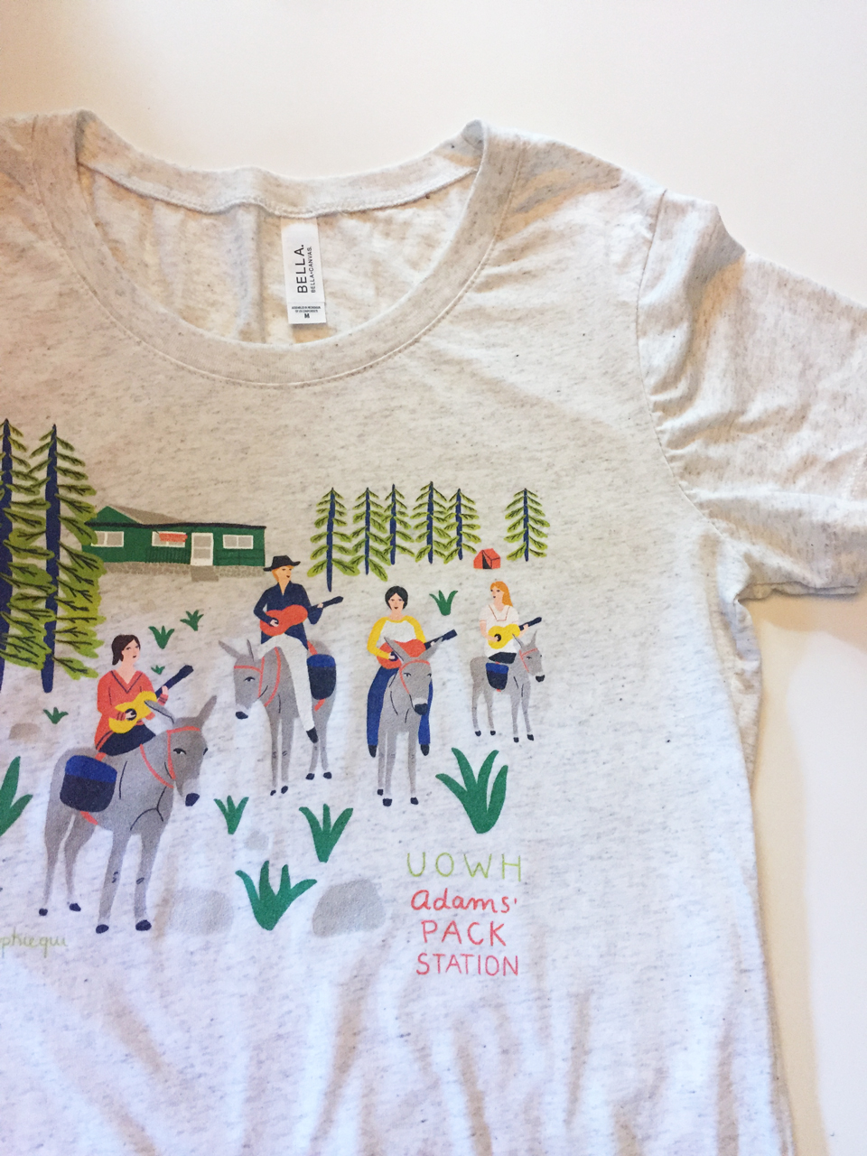 UOWH Adams' Pack Station Triblend T-Shirt (Unisex) - This shirt commemorates the whimsical coming together of the Ukulele Orchestra of the Western Hemisphere(a.k.a. UOWH) and the donkeys of Adams' Pack Station. From $27, available in Oatmeal Tri-Blend or White Fleck (looks grey).