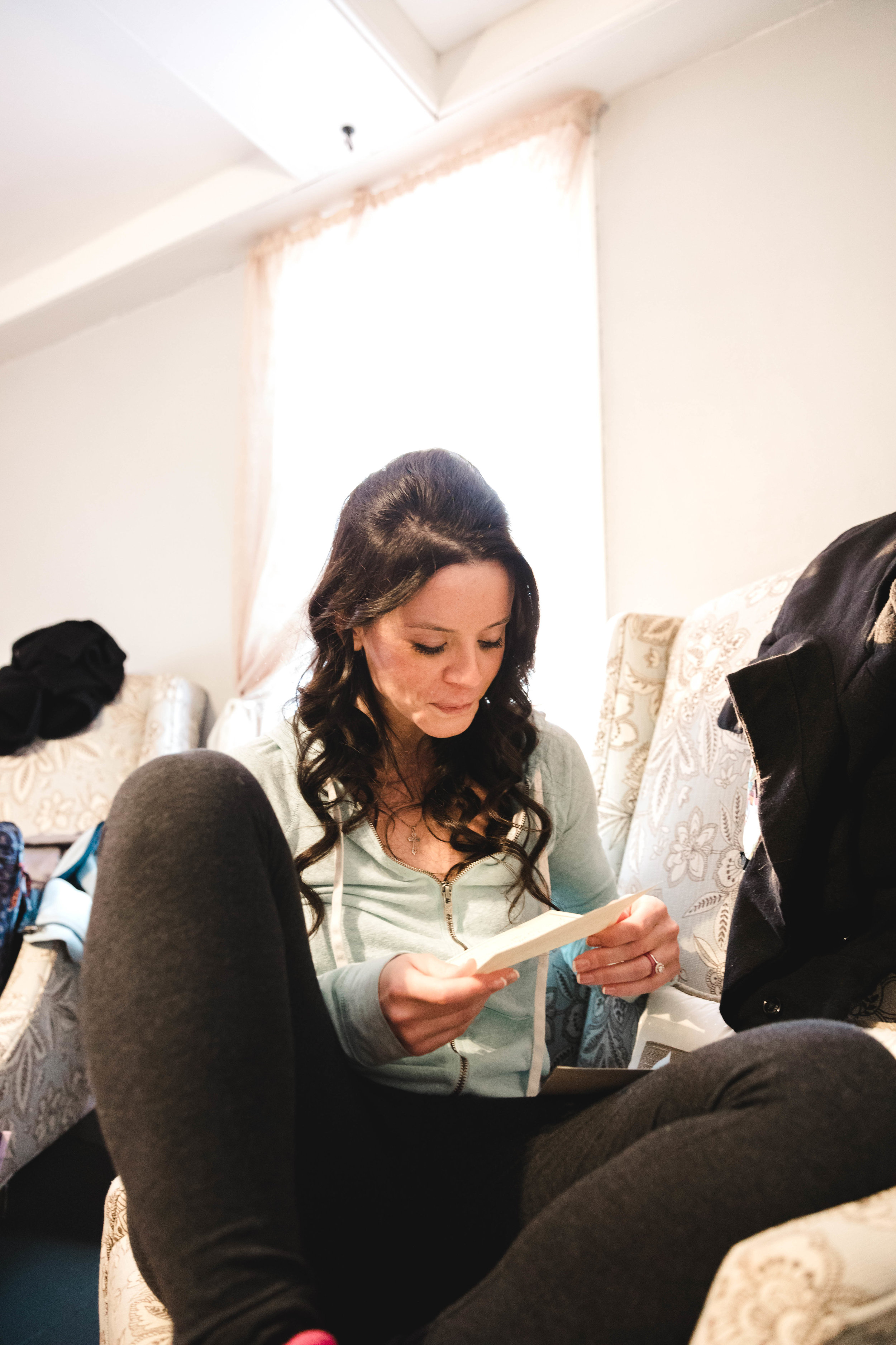 bride reading letter from groom before wedding