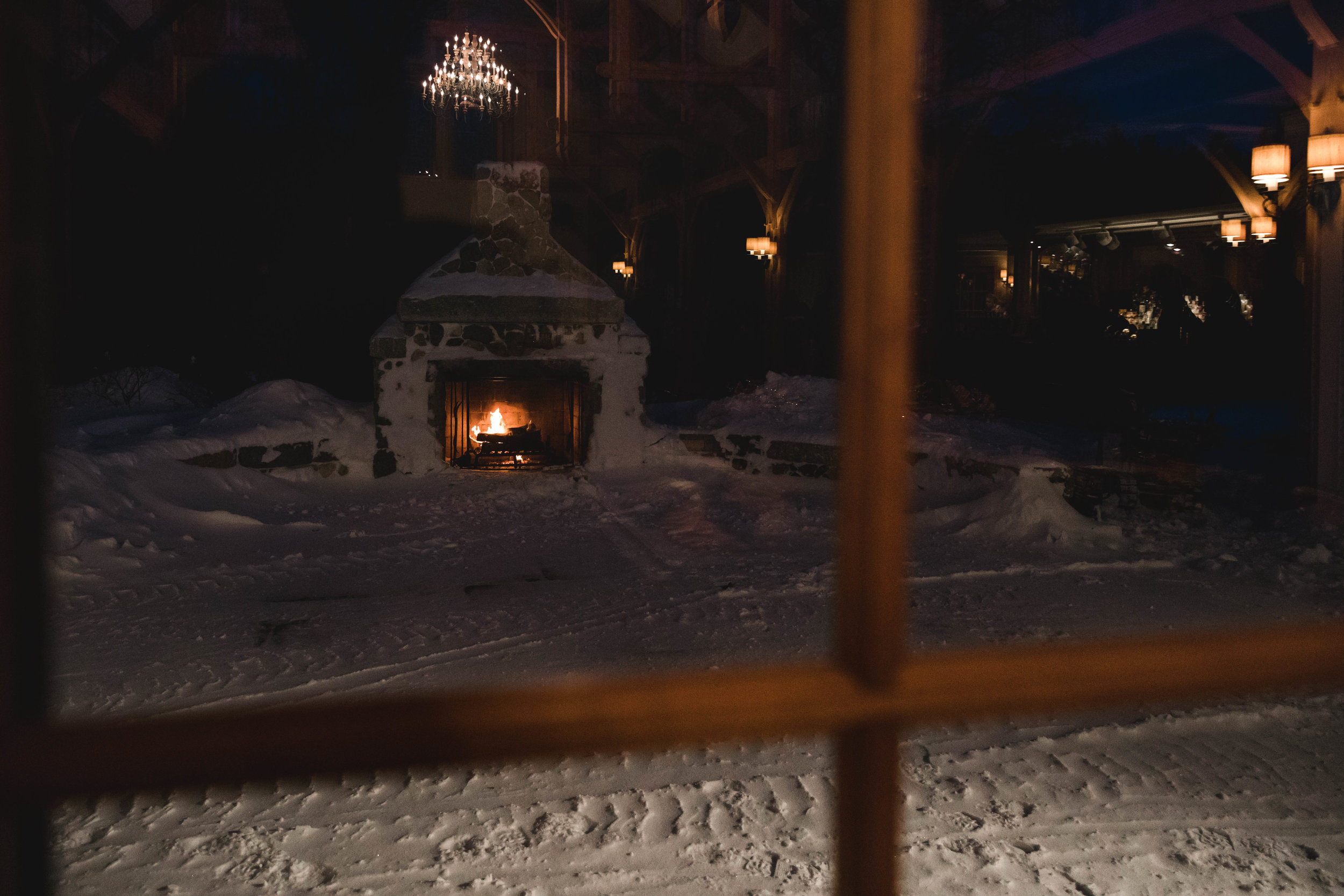 outdoor fireplace at winter wedding