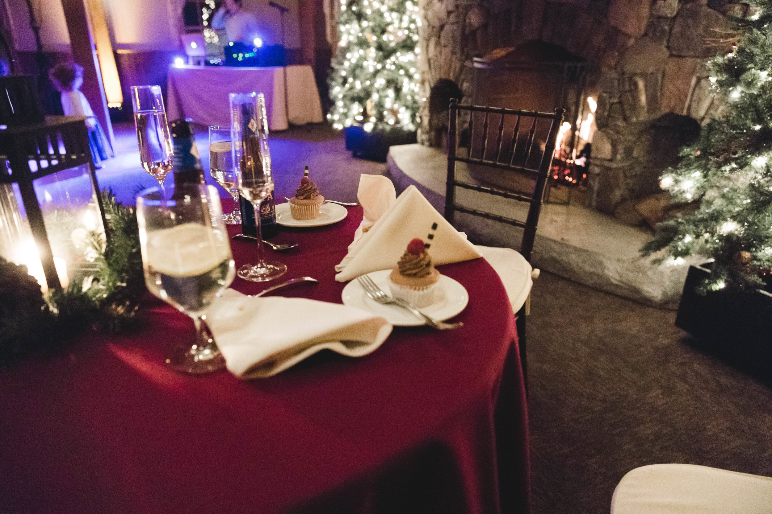 sweetheart table with cake and Champagne at winter wedding