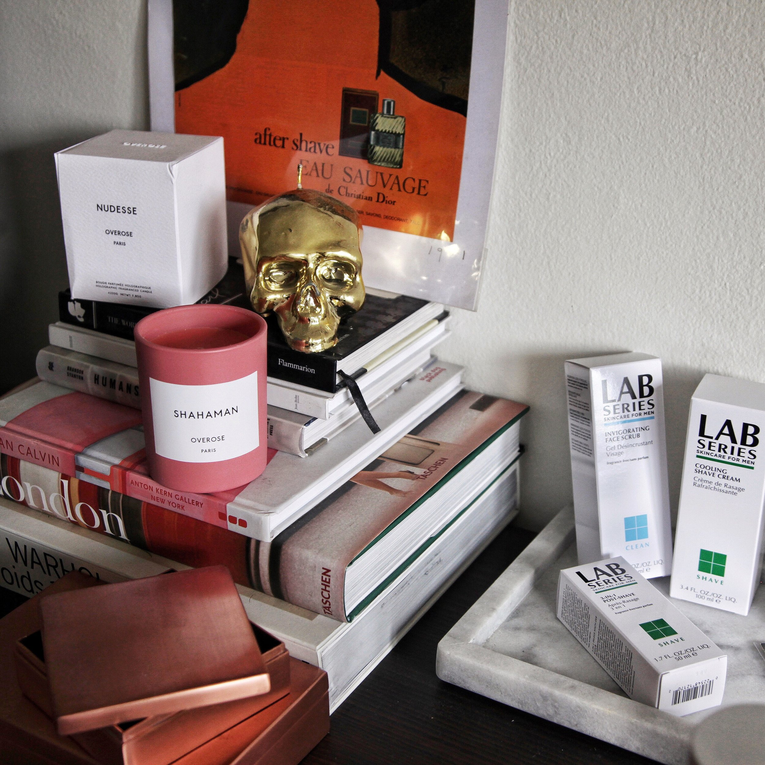 Clockwise from top left:  Overose Candles ,  D.L. & Co. Skull Candle ,  Assorted Lab Series ,  Assorted Taschen Books