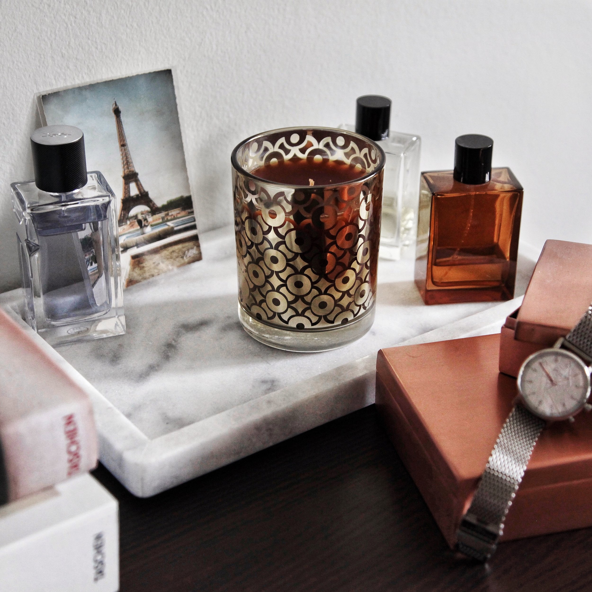 Clockwise from top left:  YSL Y Fragrance ,  Aromatique Candle ,  Helmut Lang Fragrances ,  Kronaby Watch
