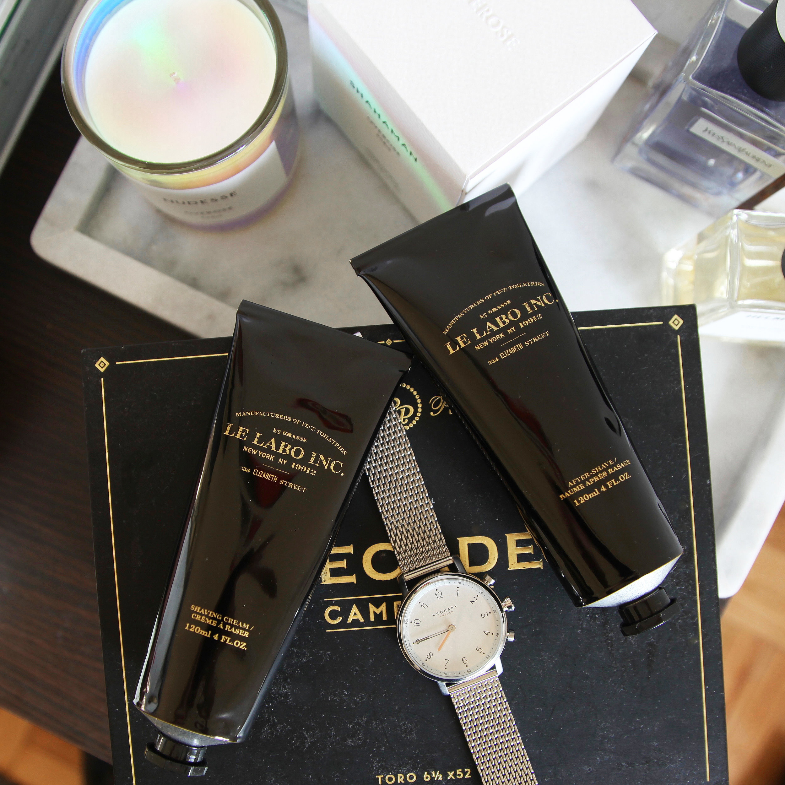 Clockwise from left:  Overose Candles ,  YSL Y Fragrance ,  Helmut Lang Fragrances ,  Le Labo Shaving Products ,  Kronaby Watch