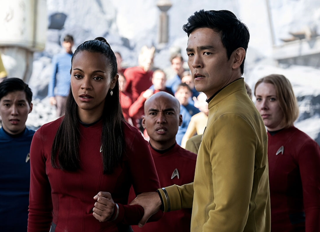 Zoe Saldana (left) as Lieutenant Nyota Uhura and John Cho (right) as Helmsman Hikaru Sulu act like they've been playing these roles for years now. Seven years to be exact.