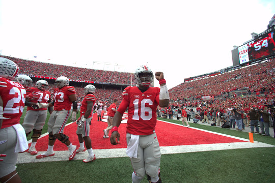 JT Barrett has thrown for 888 yards and 14 touchdowns this season, along with 205 yards rushing and 3 rushing touchdowns.