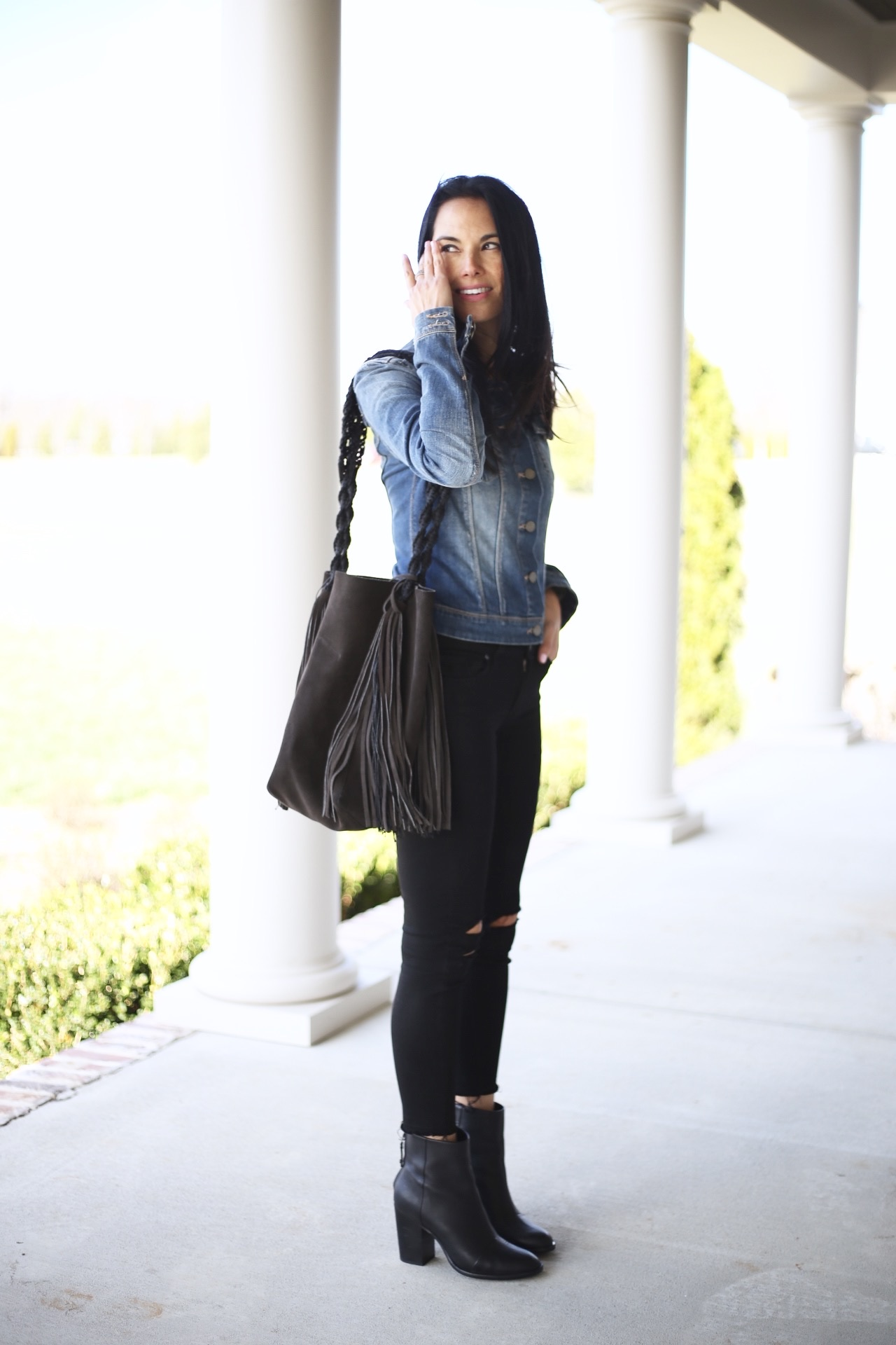 Handbag  similar  | destructed  denim  | denim jacket  similar  | boots  similar  sale | photo by Sydney Clawson |