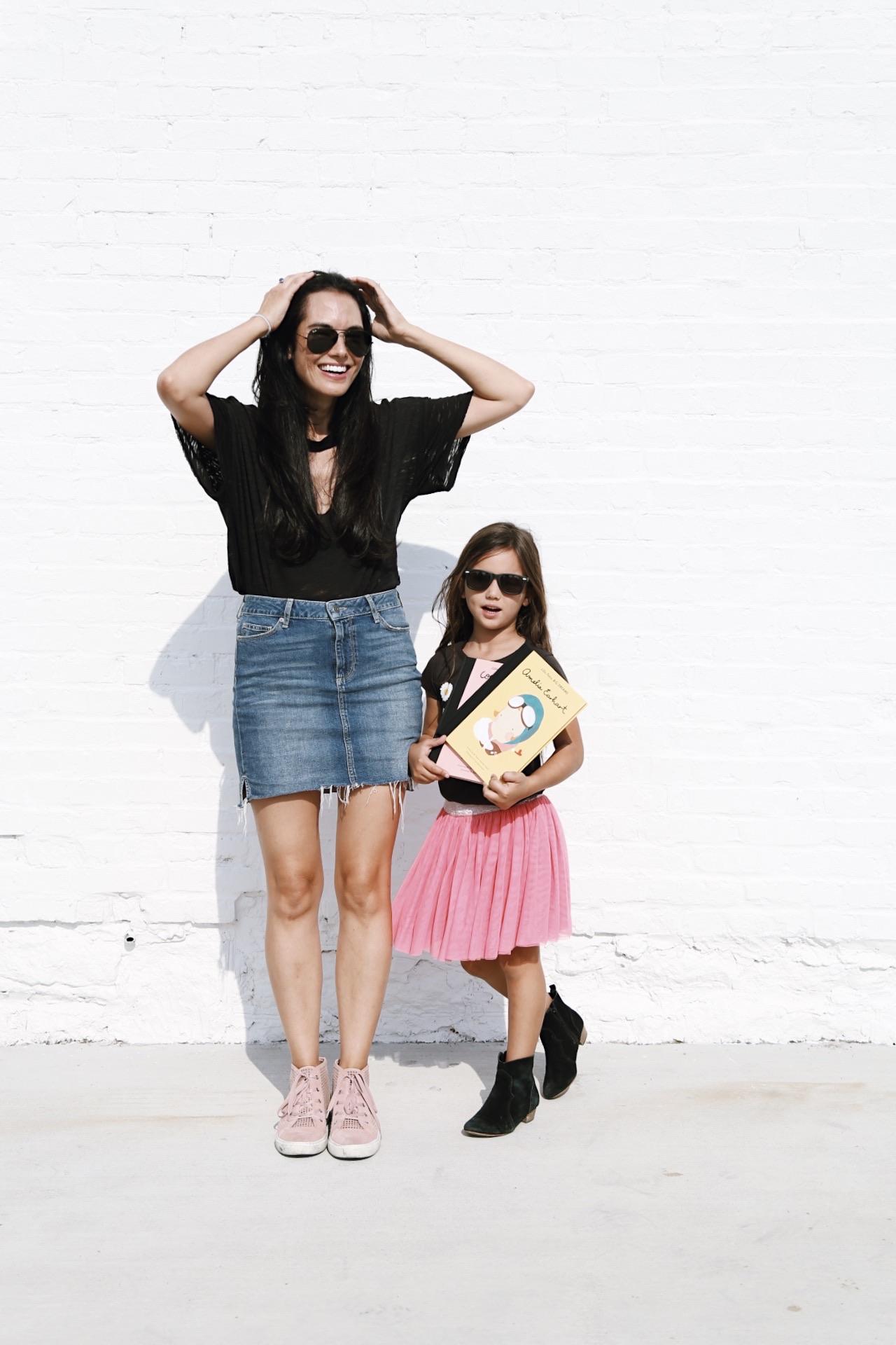 |  aviators  |  black cutout tee  |  denim skirt  |  high tops  |  youth sunnies similar |  books  |  booties  |  skirt  |  tee (similar  |   | image by Sydney Clawson |