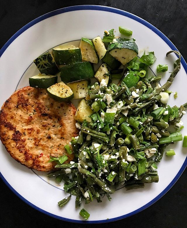 "It gives me such joy when my ""random stuff in the fridge"" meals turn out well. Leftover string beans mixed with feta, scallions, and cilantro with meal prepped roasted zucchini and a @traderjoes chile lime chicken burger (highly recommend) 😉"