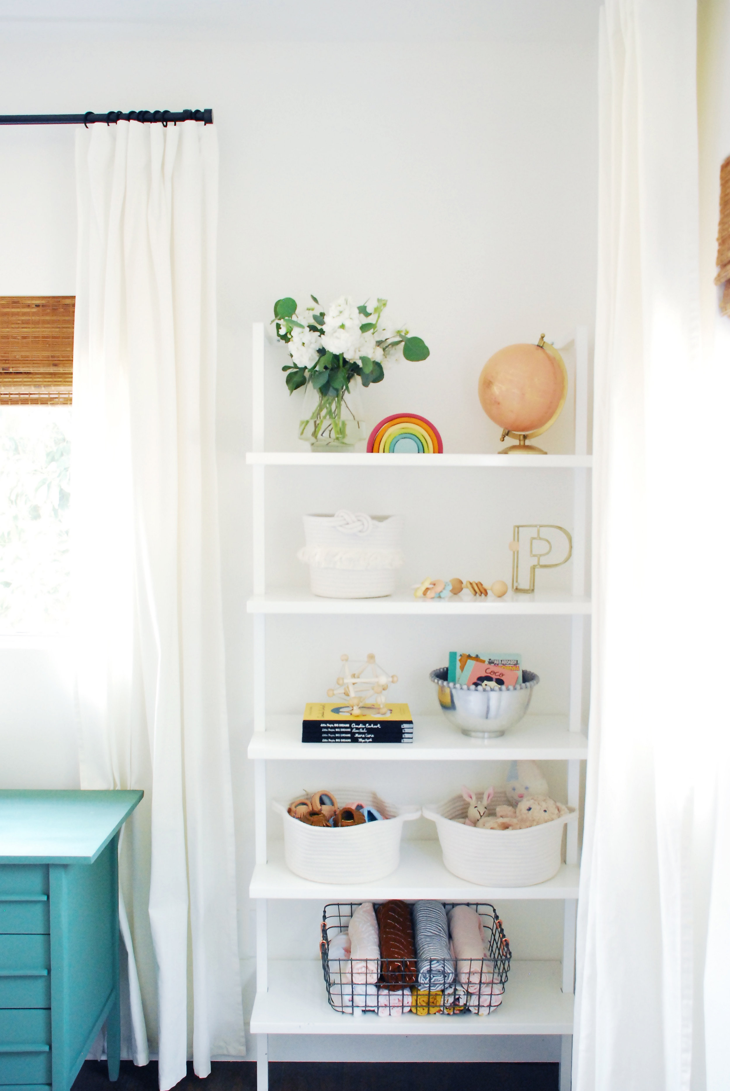 Bright white baby nursery by Stay Interiors
